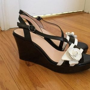 Black wedges with white flower on the front strap